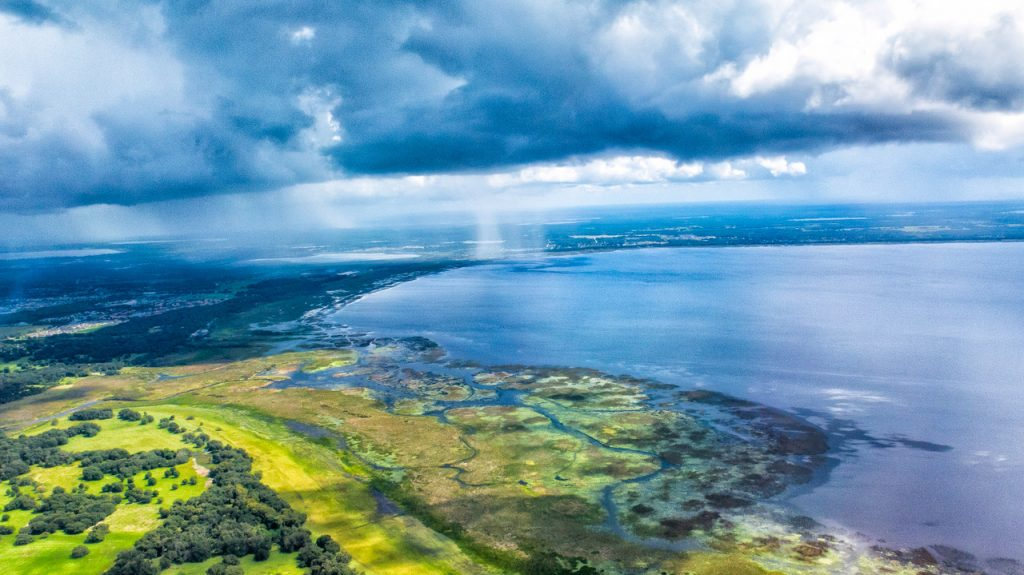 Aerial view with a storm at the edge of the sea.
